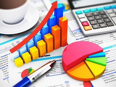 31137749 - business finance, tax, accounting, statistics and analytic research concept: macro view of office electronic calculator, bar graph charts, pie diagram and ballpoint pen on financial reports with colorful data with selective focus effect